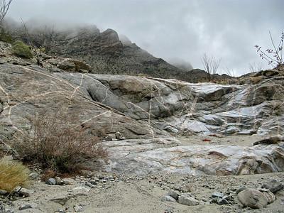Low clouds and well worn rock