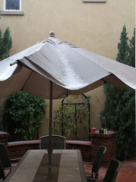 Hail stones accumulate on a patio umbrella in Ladera Ranch, March 8, 2013