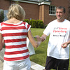Erica Galvin/NEWS<br /> Steve Fornataro passes out blow-pops to voters walking into to St. John's Lutheran Church.
