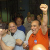 Erica Galvin/NEWS<br /> Mark Panella and George Gabriel celebrate after hearing the final results of the polls.