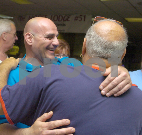 Erica Galvin/NEWS<br /> Anthony Adamo receives congratulations from a friend after discovering his victory for City Council.