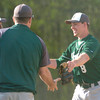 Erica Galvin/NEWS<br /> Laurel pitcher Brandon Ritchie receives congratulations from the coaches after defeating Neshannock yesterday.