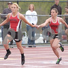 Erica Galvin/NEWS<br /> Mohawk's Mikala Mangino hands the baton off to McKenzie Stelter during the 4x100 meter relay.