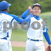 Erica Galvin/NEWS<br /> Drew Robinson high fives pitcher Devan Schuller  after defeating North Catholic yesterday at Chippewa Park.