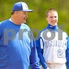 Erica Galvin/NEWS<br /> Union head coach Mark Stanley jokes around with Wayne Seamans during a change of pitcher timeout after hitting a double in the sixth inning.