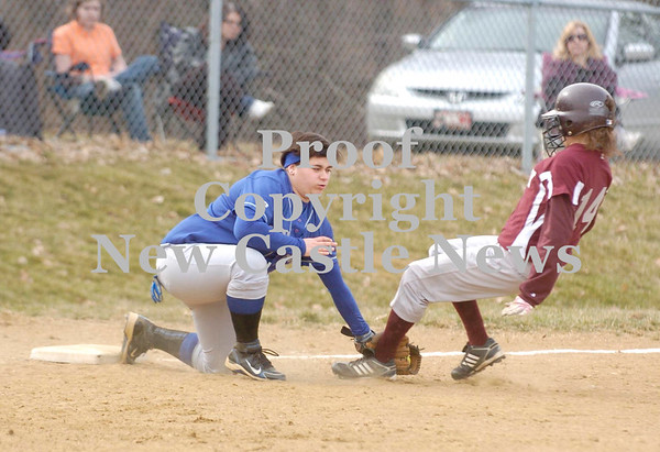 Erica Galvin/NEWS<br /> Union's Gina Gaibis tags out Quigley Catholic's Julia Yaccich in the third inning.