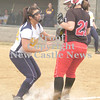 Erica Galvin/NEWS<br /> Shenango's Jenna Petrucci tags out Mohawk's Lucia Fee during a rundown in the fourth inning.
