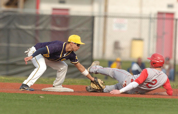 Erica Galvin/NEWS<br /> Shenango's Greg DePorzio tags out Neshannock's Frank Fraschetti as he attempts to steal second in the second inning.
