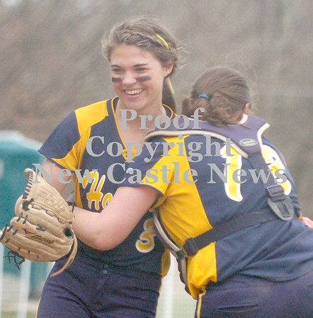 Erica Galvin/NEWS<br /> Wilmington catcher Courtney Cohen hugs pitcher Abby Sotter after defeating Neshannock yesterday.