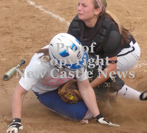 Erica Galvin/NEWS<br /> New Castle catcher Aleigha Withrow tags out Ellwood City's Mallory Swogger at the plate in the sixth inning.