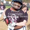 Erica Galvin/NEWS<br /> Dana Perrotta hugs Abba Frengel after Frengel hit the winning run in to win the game in extra innings.