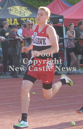 Erica Galvin/NEWS<br /> Lucas Grim rounds a corner of the track during his 800-meter run.