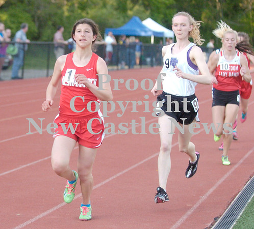 Erica Galvin/NEWS<br /> Neshannock's Lizzie Manickas takes the lead on the third lap of the 3200 meter run.