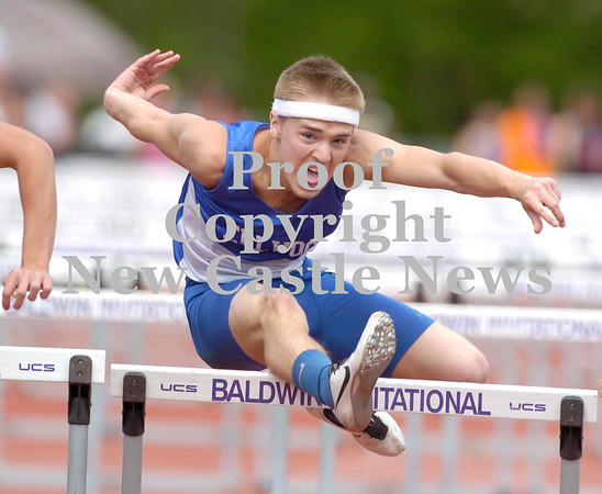 Erica Galvin/NEWS<br /> Ellwood City's Keaton Docchio clears a hurdle during the 110-meter hurdle finals.