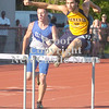 Erica Galvin/NEWS<br /> Shenango's Ron Davis clears a hurdle as Ellwood City's Kevin Court shortly trails behind during the 300-meter hurdles.
