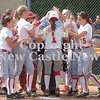 Erica Galvin/NEWS<br /> The Neshannock softball team greets and congratulates Rayanna Furst after hitting a home in the fifth inning.