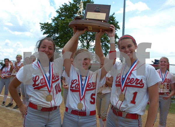 Erica Galvin/NEWS<br /> The Neshannock softball team seniors from left, Katie Burrelli, Jamie Graziani and Rayanna Furst hold up the Class A WPIAL Championship trophy after defeating Carmichaels 10-4.