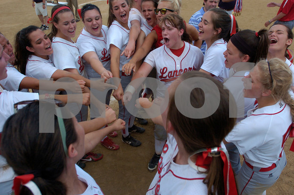 Erica Galvin/NEWS<br /> The Neshannock softball team huddles up together after defeating Carmichaels for the Class A WPIAL Championship at California University.