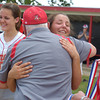 Erica Galvin/NEWS<br /> Neshannock senior Katie Burrelli hugs head coach Tracy Kimmel after receiving her WPIAL Class A Championship medal. The Lady Lancers won their first WPIAL title with a 10-4 victory over Carmichaels.