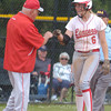 Erica Galvin/NEWS<br /> Neshannock head coach Tracy Kimmel fist bumps Madison Shaffer after hitting a triple in the first inning.