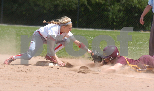 Erica Galvin/NEWS<br /> Neshannock's Jamie Graziani tags out Elk County Catholic's Jessie Ginther while attempting to steal in the fifth inning.
