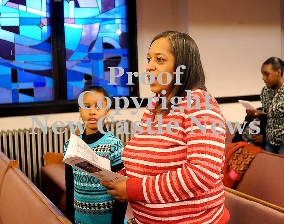 "Courtney Caughey-Stambul/NEWS<br /> Marcee Richardson and Billie Craig, 9, sing ""We Shall Overcome"" during Sunday service to remember Dr. Martin Luther King Jr."