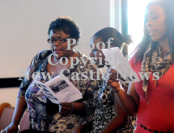 """Courtney Caughey-Stambul/NEWS<br /> Congregation members sing along to """"Life Every Voice and Sing"""" on Sunday."""
