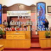 """Courtney Caughey-Stambul/NEWS<br /> Members of the clergy sing """"We Shall Overcome"""" at Sunday's service in honor of the late Dr. Martin Luther King Jr."""