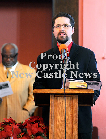 Courtney Caughey-Stambul/NEWS<br /> Rev. Nathan Loudon of First Presbyterian Church reads the Litany of Commemoration on Sunday. To the left, Rev. Eric D. Brooks reads along.
