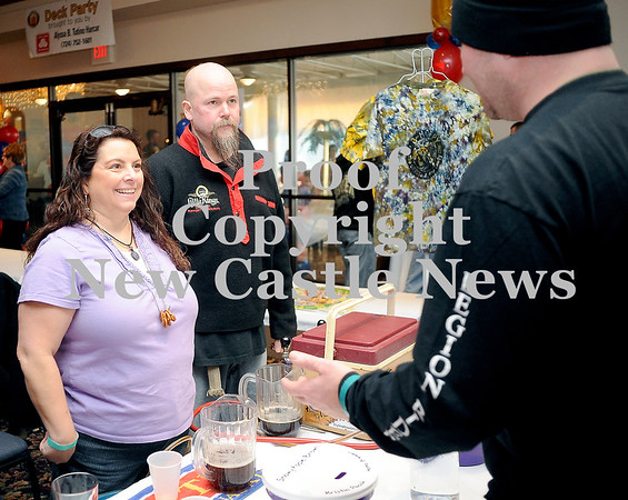 Courtney Caughey-Stambul/NEWS<br /> Local brewers from The Pumphouse in Struthers, OH provide guests with samples of their famous Wonka's Wonder Triple Chocolate Stout.