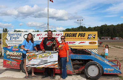 "Jeremy ""Jake"" Dickman Xtreme 100 2nd Place #49 Brian Ruhlman with Jeannie Robinson (right) and Debbie Dickman.  Chuck's Discount Foods"