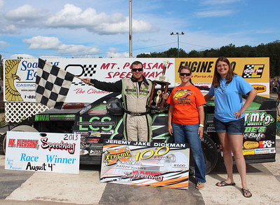 "Jeremy ""Jake"" Dickman Xtreme 100 Feature Winner #82 Jacob Poel with Jeannie Robinson (middle) and Debbie Dickman.  Chuck's Discount Foods"