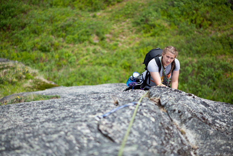 Tracy works out the crux moves on <i>A Bullet From Fritz 5.7</i> on the Monolith in Archangel Valley.