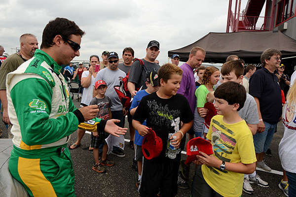 """Race winner Andrew Ranger signs autographs for some fans during the """"Fan Walk"""" before the race.<br /> <br /> ©Sam Feinstein"""