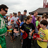 "Race winner Andrew Ranger signs autographs for some fans during the ""Fan Walk"" before the race.<br /> <br /> ©Sam Feinstein"