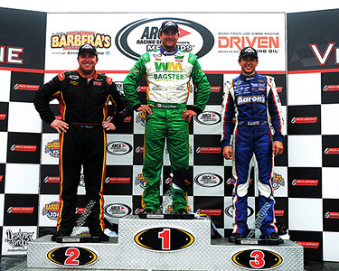 "The podium at the July 27 ARCA Barbera's Autoland 150 race at New Jersey Motorsports Park had Chase Elliot from Dawsonville, GA, in third place, Tom Hessert from Cherry Hill, NJ, in second place, and Andrew Ranger from Roxton Pond, Quebec, in first.  Ranger can now claim a ""three-peat"" at NJMP, since he won in 2011, 2012, and 2013.<br /> <br /> ©Sam Feinstein"
