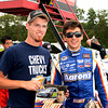 """Chase Elliott poses for photos with one of his fans during the """"Fan Walk"""" before the ARCA race.<br /> <br /> ©Sam Feinstein"""