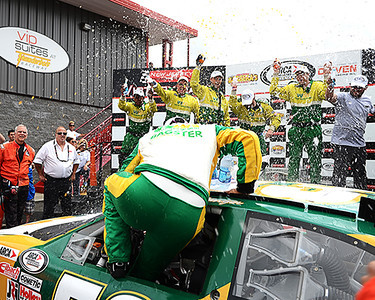 Andrew Ranger gets doused with water by his crew as he climbs out of his Waste Management Bagster Dodge after winning the ARCA Barbera's Autoland 150 race at New Jersey Motorsports Park on Sunday, July 27.  <br /> <br /> ©Sam Feinstein