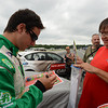 "Race winner Andrew Ranger signs an autograph for a fan during the ""Fan Walk"" before the race.<br /> <br /> ©Sam Feinstein"