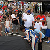 """Chase Elliott signs autographs for some fans during the """"Fan Walk"""" before the race.<br /> <br /> ©Sam Feinstein"""