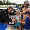 """Steve Minghenelli signs autographs for some of his fans during the """"Fan Walk"""" before the ARCA race.<br /> <br /> ©Sam Feinstein"""