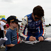 """Chase Elliott signs an autograph for a young fan during the """"Fan Walk"""" before the race.<br /> <br /> ©Sam Feinstein"""
