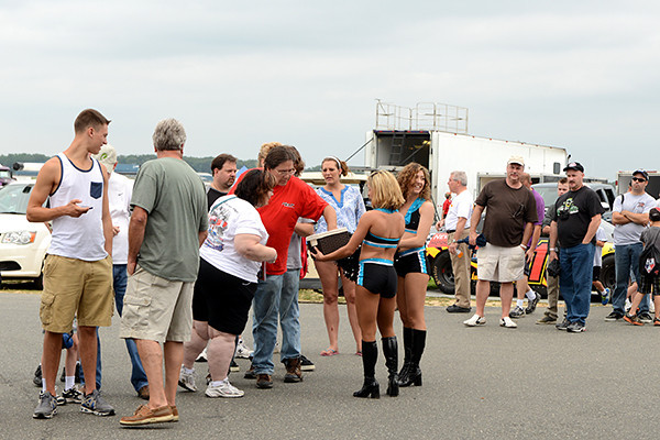 """Philadelphia Soul arena football cheerleaders visit with fans before the """"Pit Walk.""""<br /> <br /> ©Sam Feinstein"""