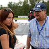 """Milka Duno, from Caracas, Venezuela, chats with of her fans during the """"Fan Walk"""" before the ARCA race.  Milka has competed in IndyCar, the 24 Hours of LeMans, GrandAm, and several other series.  She has been on the ARCA circuit since 2010.<br /> <br /> ©Sam Feinstein"""