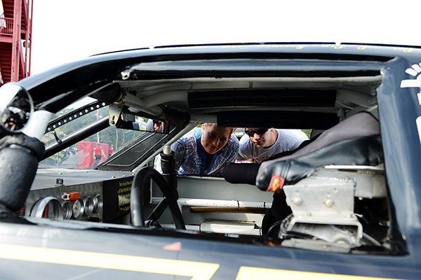 """Some fans get a close look at the inside of an ARCA car - """"#51.""""<br /> <br /> ©Sam Feinstein"""