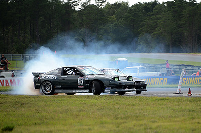 The U.S. Drift competition after the ARCA race at NJMP was pretty cool. Look again and you will realize that there are two cars in this photo. Although the tires are pointed towards the drivers' right, they were negotiating a left curve, drifting side-by-side the whole way through.<br /> <br /> ©Sam Feinstein