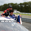 Chase Elliott climbs out of his car at the end of the 150 mile ARCA race.<br /> <br /> ©Sam Feinstein