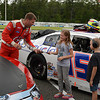 """Will Kimmel signs autographs for some of his fans during the """"Fan Walk"""" before the ARCA race.<br /> <br /> ©Sam Feinstein"""