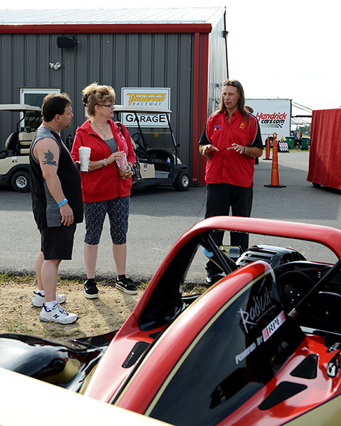 Chuck explains the 2-seat race car used for driver education.<br /> <br /> ©Sam Feinstein