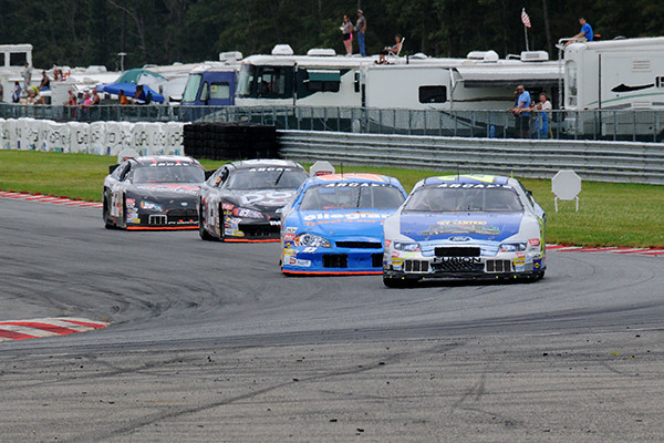 Coming into turn 1 where the campers have a great view of the action.<br /> <br /> ©Nate Feinstein